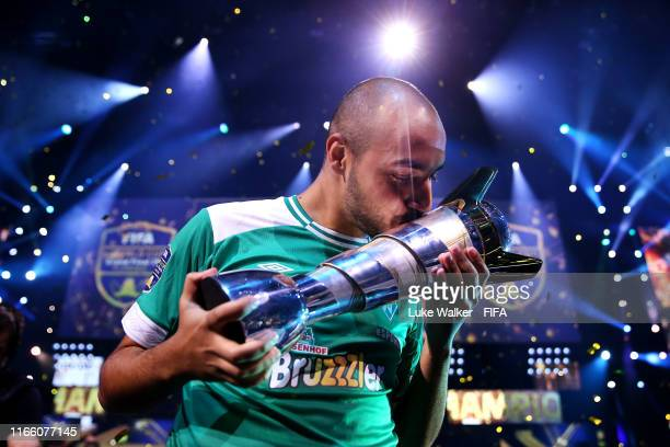Mo Harkous of Germany kisses the trophy following victory in the FIFA eWorld Cup Final against Mosaad Aldossary of Saudi Arabia during Finals day of...