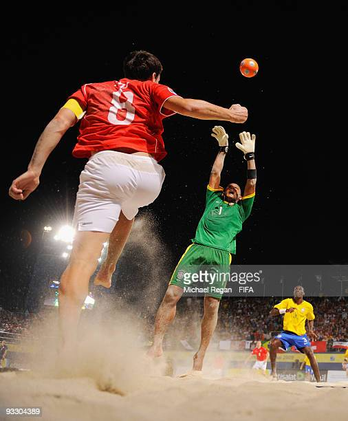 Mo Jaeggy of Switzerland tries to head the ball past Brazil goalkeeper Mao during the FIFA Beach Soccer World Cup Final between Brazil and...