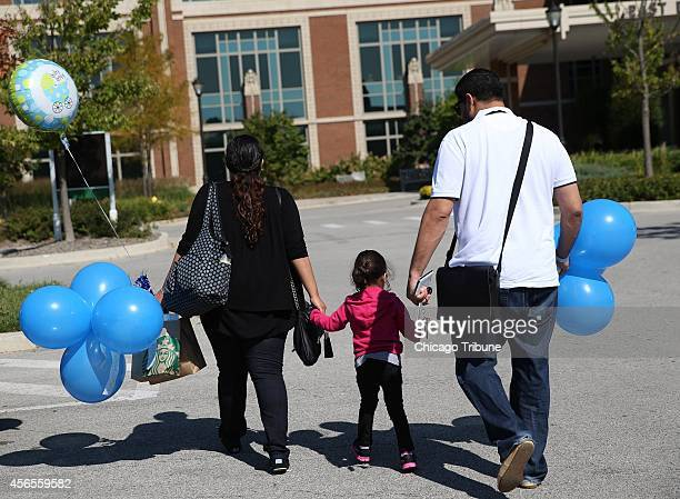 Mo Khaja right whose wife recently gave birth to a baby boy faces the same challenges as the Mastrino family as he arrives at Elmhurst Memorial...