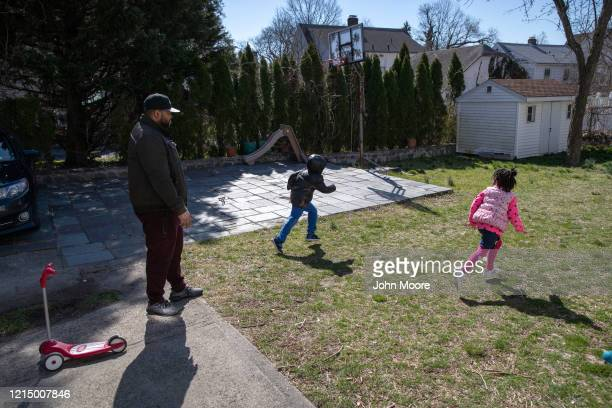 Mo Major plays in the back yard with his children Max and Marley on March 26 2020 in Mount Vernon New York Mo was laid off as a chef consultant and...