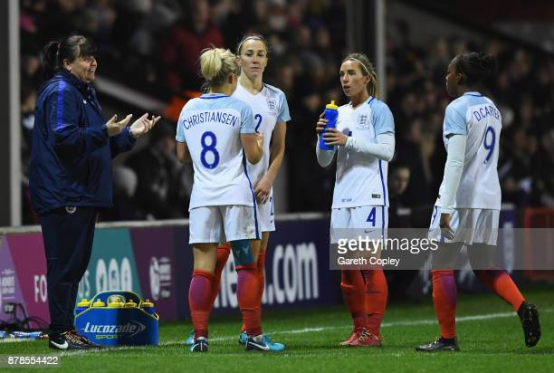 Mo Marley interim manager of England in discussion with Isobel Christiansen Lucy Bronze Jordan Nobbs and Danielle Carter of England during the FIFA...
