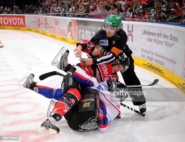 Mo Mueller of Cologne has a fight with Ryan Prestin of Ingolstadt during the DEL playoff match between Koelner Haie and ERC Ingolstadt on March 26...