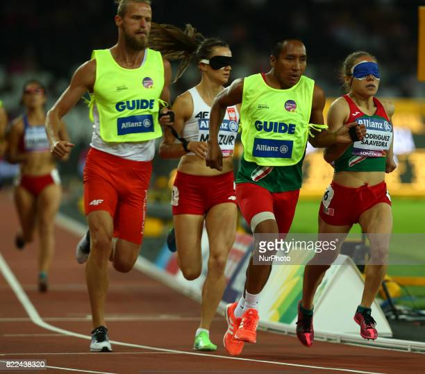Mo Rodriguez Saavedra of Mexico and GuideFelipe Modesto Eustasio compete Women's 1500m T11 Final during World Para Athletics Championships Day Three...