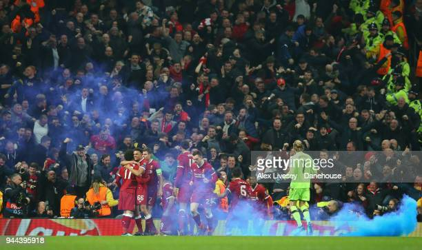 Mo Salah of Liverpool celebrates with team mates after scoring his goal during UEFA Champions League Quarter Final Second Leg match between...
