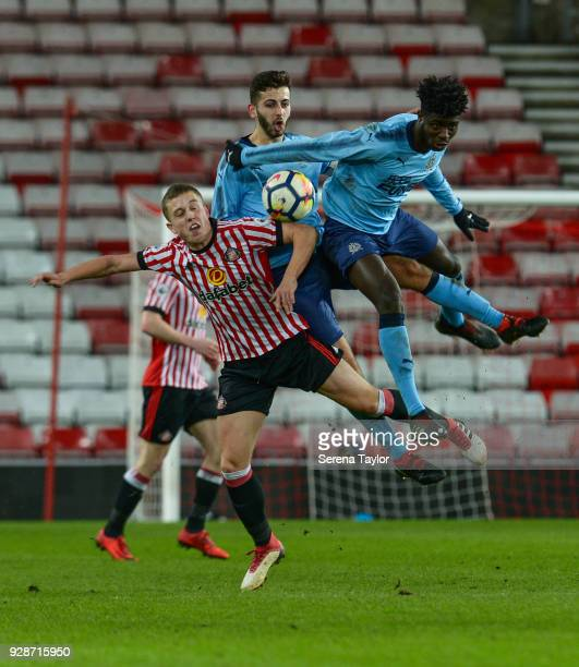 Mo Sangare of Newcastle United wins a header over Jake Jackett of Sunderland during the Premier League International Cup between Sunderland and...