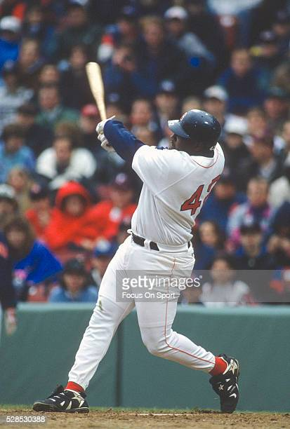 Mo Vaughn of the Boston Red Sox bats during an Major League Baseball game circa 1995 at Fenway Park in Boston, Massachusetts. Vaughn played for the...