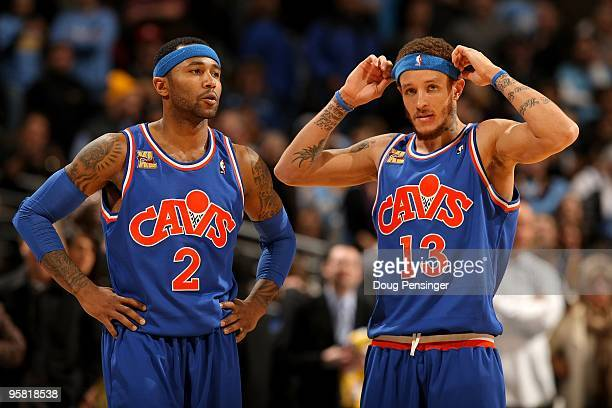 Mo Williams and Delonte West of the Cleveland Cavaliers look on during a break in the action against the Denver Nuggets during NBA action at Pepsi...