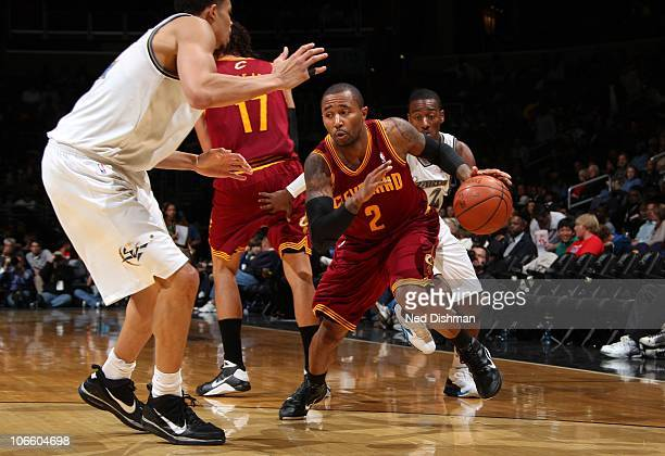 Mo Williams of the Cleveland Cavaliers drives against JaVale McGee of the Washington Wizards at the Verizon Center on November 6 2010 in Washington...