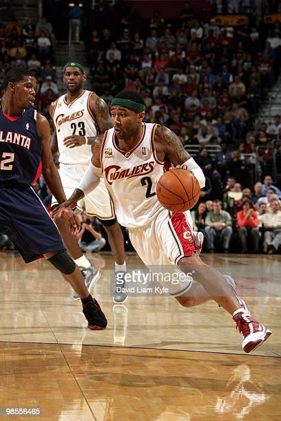 Mo Williams of the Cleveland Cavaliers drives to the basket against Joe Johnson of the Atlanta Hawks during the game at Quicken Loans Arena on April...