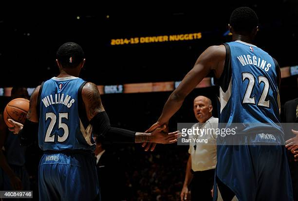 Mo Williams of the Minnesota Timberwolves slaps hands with teammate Andrew Wiggins during the game against the Denver Nuggets on December 26 2014 at...