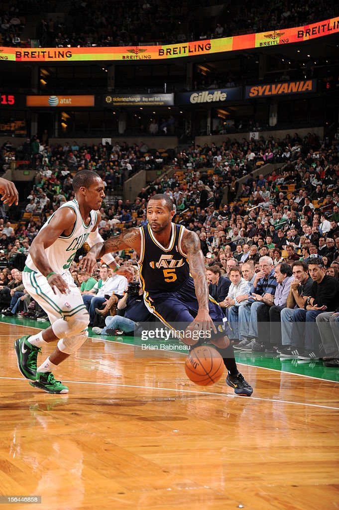 Mo Williams #5 of the Utah Jazz drives to the basket against Rajon Rondo #9 of the Boston Celtics on November 14, 2012 at the TD Garden in Boston, Massachusetts.