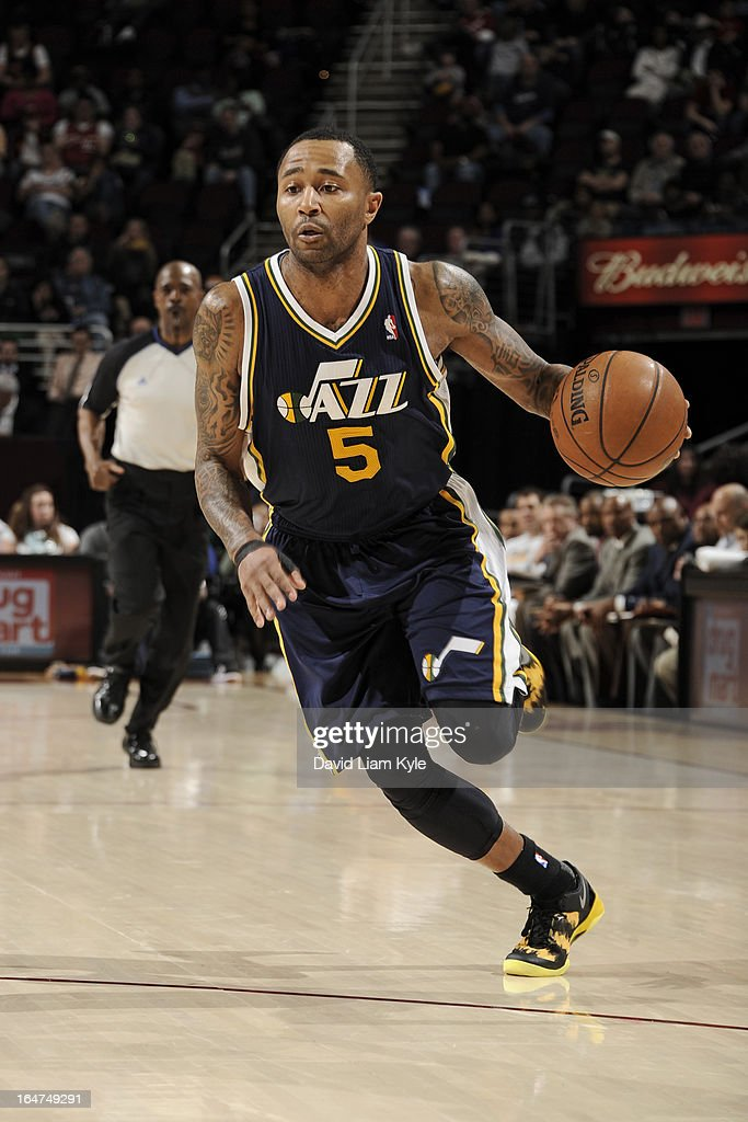 Mo Williams #5 of the Utah Jazz drives to the basket against the Cleveland Cavaliers at The Quicken Loans Arena on March 6, 2013 in Cleveland, Ohio.