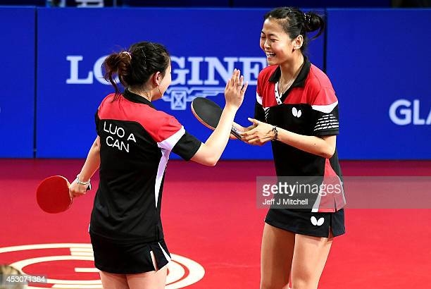 Mo Zhang and Anqi Luo of Canada celebrate against Joanna Drinkhall and Kelly Sibley of England in the Women's Doubles Bronze Medal Match at Scotstoun...