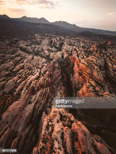moab aerial view at dusk - moab utah stock photos and pictures