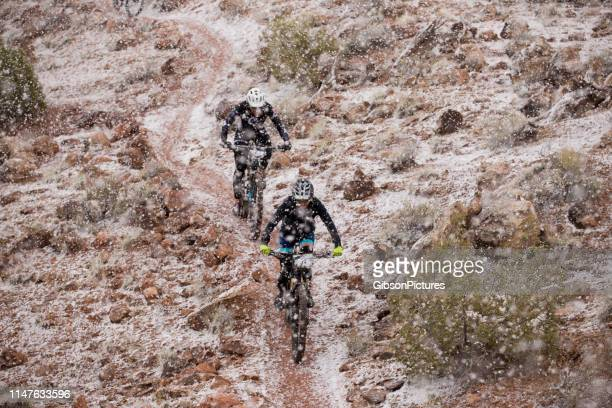 moab rocks mountain bike race - cross country cycling stock pictures, royalty-free photos & images