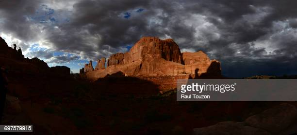 Storm clouds over Park Avenue Trail in Arches National Park.