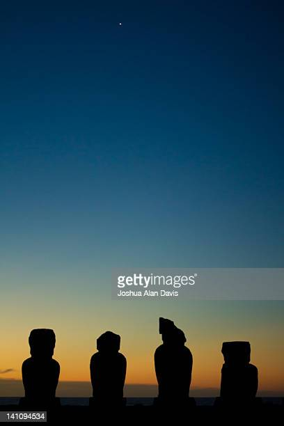 moai statues at dusk - joshua alan davis stock pictures, royalty-free photos & images