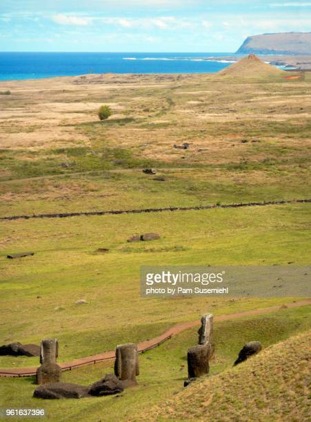 moai statues buried at rano raraku - rano raraku stock pictures, royalty-free photos & images