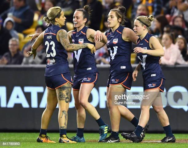Moana Hope and Daisy Pearce of Victoria celebrate a goal during the AFL Women's State of Origin match between Victoria and the Allies at Etihad...