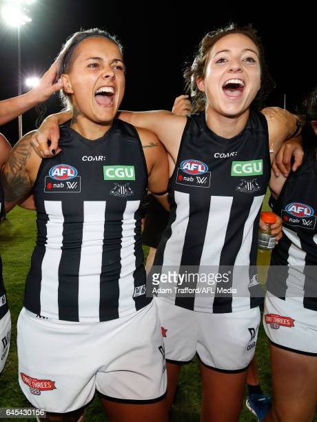 Moana Hope and Stephanie Chiocci of the Magpies sing the team song during the 2017 AFLW Round 04 match between the Western Bulldogs and Collingwood...