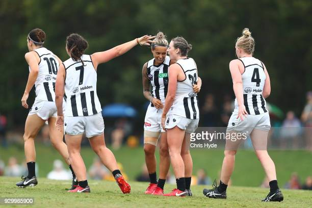 Moana Hope of the Magpies celebrates a goal during the round six AFLW match between the Brisbane Lions and the Collingwood Magpies at Moreton Bay...