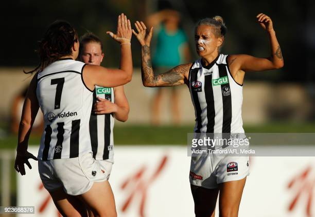 Moana Hope of the Magpies celebrates a goal with teammates during the 2018 AFLW Round 04 match between the Melbourne Demons and the Collingwood...