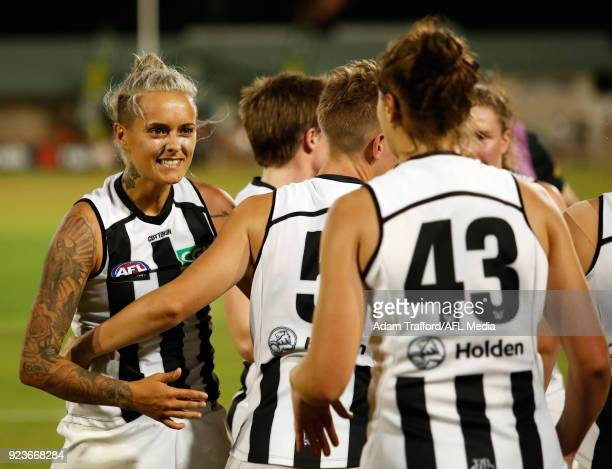 Moana Hope of the Magpies celebrates with teammates during the 2018 AFLW Round 04 match between the Melbourne Demons and the Collingwood Magpies at...