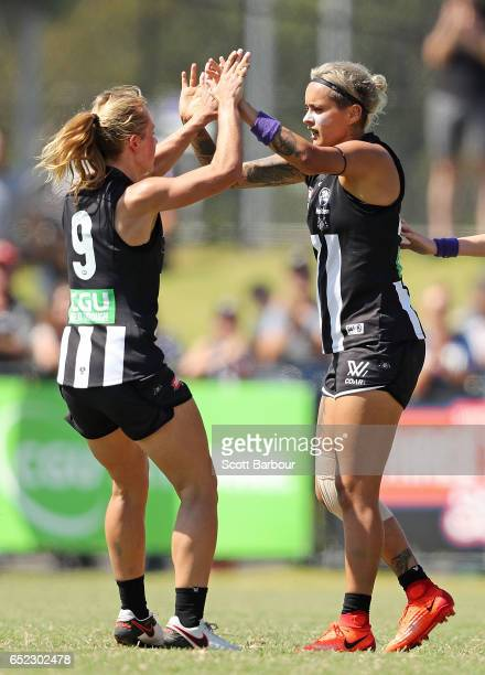Moana Hope of the Magpies is congratulated by Melissa Kuys of the Magpies and her teammates after kicking a goal during the round six AFL Women's...