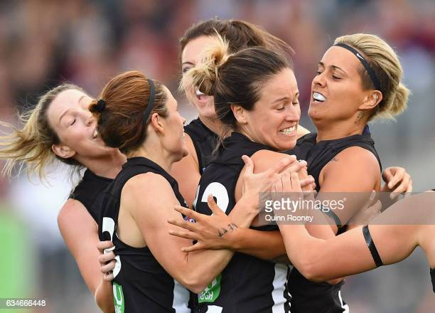 Moana Hope of the Magpies is congratulated by team mates after kicking a goal during the round two AFL Women's match between the Collingwood Magpies...