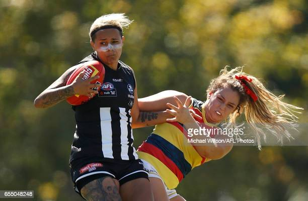 Moana Hope of the Magpies is tackled by Georgia Bevan of the Crows during the 2017 AFLW Round 07 match between the Collingwood Magpies and the...