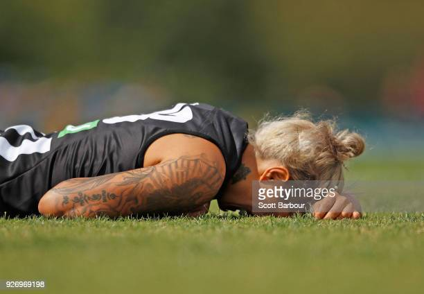 Moana Hope of the Magpies lies on the ground after being struck by Libby Birch of the Bulldogs during the round five AFLW match between the...