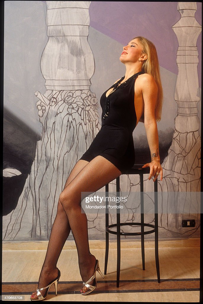 39 moana pozzi posing with a short black dress and fishnets against news photo getty images - Diva futura video ...