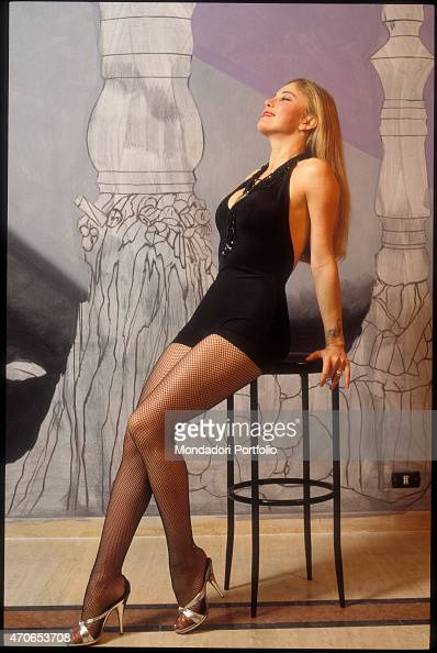 39 moana pozzi posing with a short black dress and fishnets against foto di attualit getty - Dirette diva futura ...