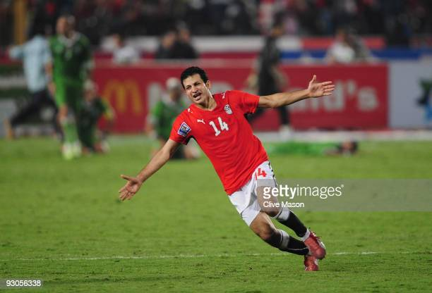 Moawad Sayed of Egypt celebrates Egypts second goal during the FIFA2010 World Cup qualifying match between Egypt and Algeria at the Cairo...