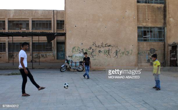 Moawiya Sayasina the Syrian activist who started scribbling antiAssad slogans in 2011 plays football with other children in a rebelheld neighbourhood...
