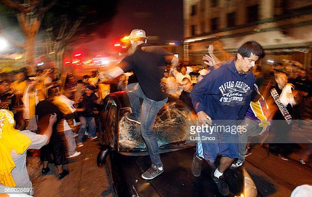A mob destroys a car parked near Staples Center on Sunday June 17 following the Lakers' championshipclinching victory in the NBA Finals
