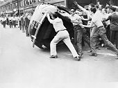 Mob of angry rioters topple an automobile owned by a black man the picture id514693134?s=170x170
