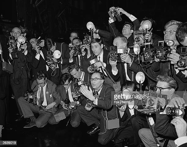 Mob of press photographers - Keystone photographer Jim Gray, can be seen in the centre looking forward - clamour to photograph the winner of the...