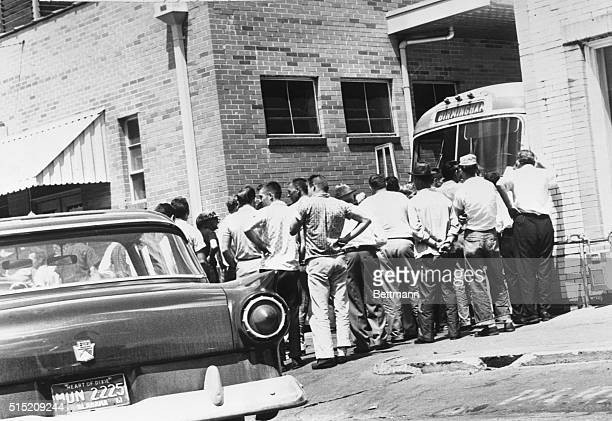 Mob of whites blocks driveway exit at bus terminal here to keep bus carrying 'Freedom Riders' from leaving Some of mob slashed tires of bus disabling...