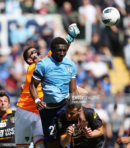 Mobido Diakite' of SS Lazio competes for the ball with Massimiliano Benassi goalkeeper of US Lecce during the Serie A match between SS Lazio and US...