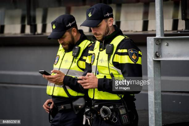 mobiele eenheid police officers with their cellphones during the Dutch Eredivisie match between sbv Excelsior Rotterdam and sc Heerenveen at Van...