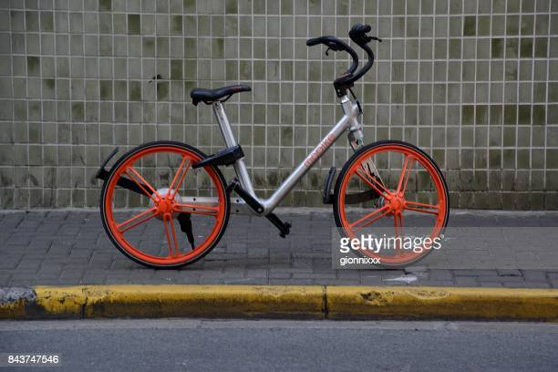 Mobike bicycle parked on a sidewalk in Jing'an district, Shanghai, China