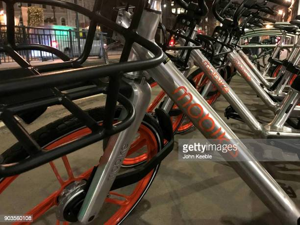 Mobike dockless bicycles are parked on the pavement near Holborn viaduct on December 8 2018 in London England