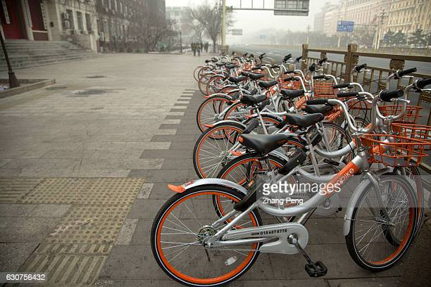 Mobikes bikes lined up on the streets Mobike is one of the leading bikesharing companies starting business in April of 2016 and developing fast in...