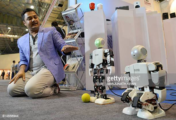 A mobile app based remote controlled NINO Robot kicks a ball at the stall of an electronics vendor at the India Gadgetz Expo 2016 show in Bangalore...
