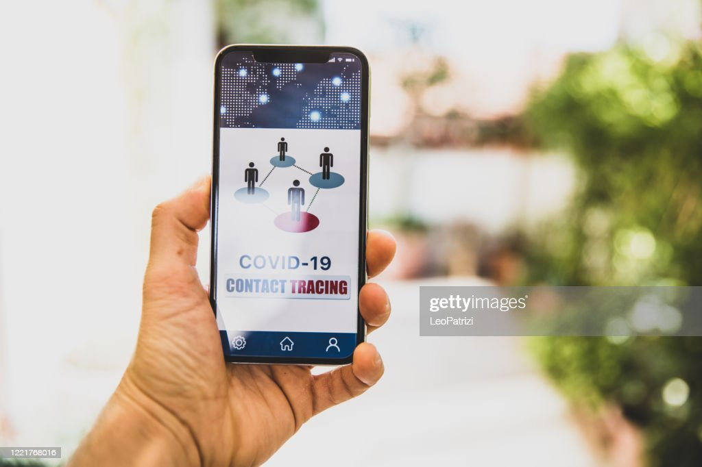 Mobile APP contact tracing adopted by national Governments to stop Covid-19 pandemic : Stock Photo