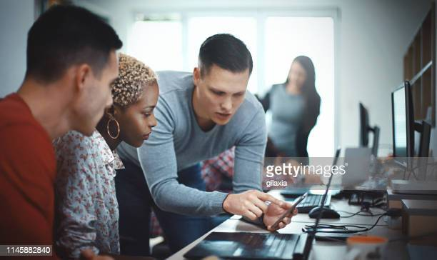 mobile apps developers at the office. - computer software stock pictures, royalty-free photos & images