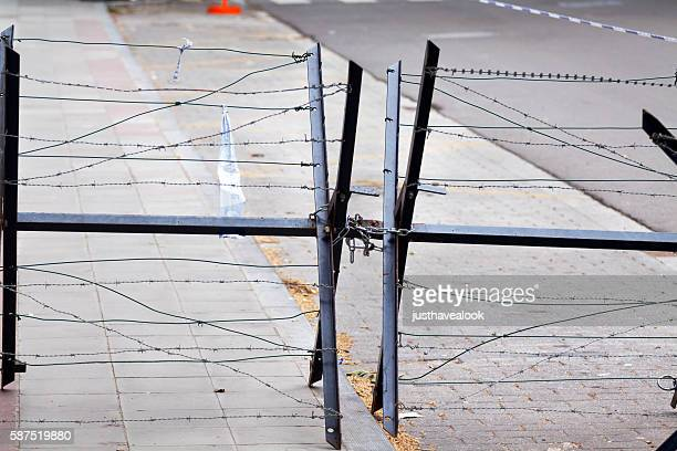 Mobile barbed wire fence of police