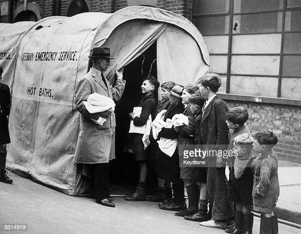 Mobile bath unit, supplied by Lever Brothers to blitzed areas for use by bombed-out families.