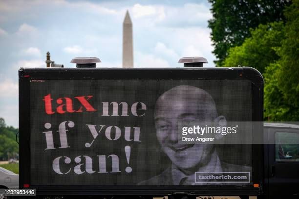 Mobile billboard calling for higher taxes on the ultra-wealthy depicts an image of billionaire businessman Jeff Bezos, near the U.S. Capitol on May...